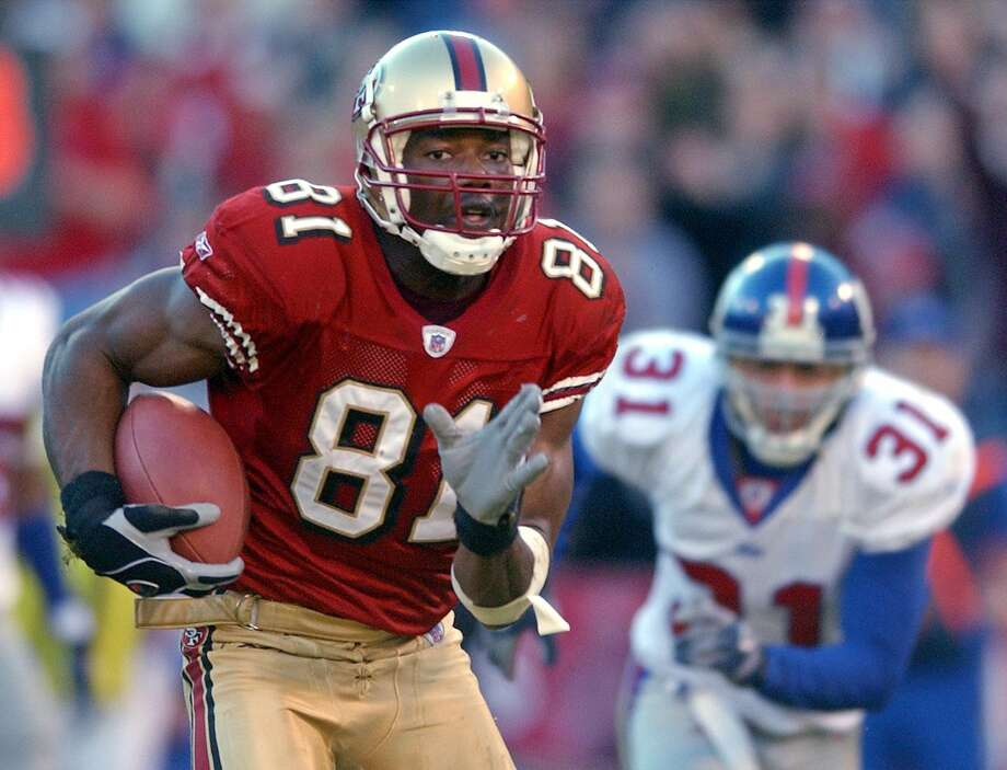 San Francisco 49ers' Terrell Owens runs for a touchdown in the third quarter as New York Giants Jason Sehorn gives chase during the  NFC Wild Card playoff game in San Francisco, Sunday, Jan. 5, 2003.  (AP Photo/Julie Jacobson) Photo: JULIE JACOBSON, Associated Press