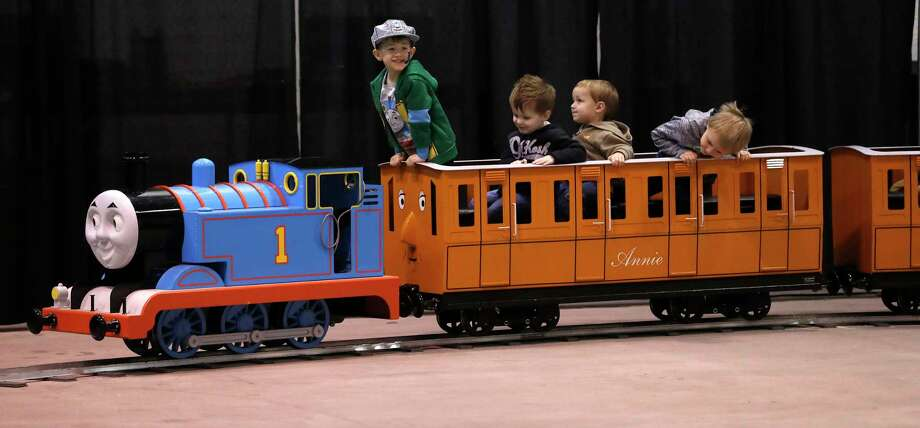 Gavin Schmidt, 4, acts as the unofficial conductor of the Thomas the Tank Engine ride Saturday at the World's Greatest Hobby on Tour at NRG Park Arena in Houston, where model train enthusiasts demonstrated their pride and skills. Photo: Karen Warren, Staff / © 2018 Houston Chronicle