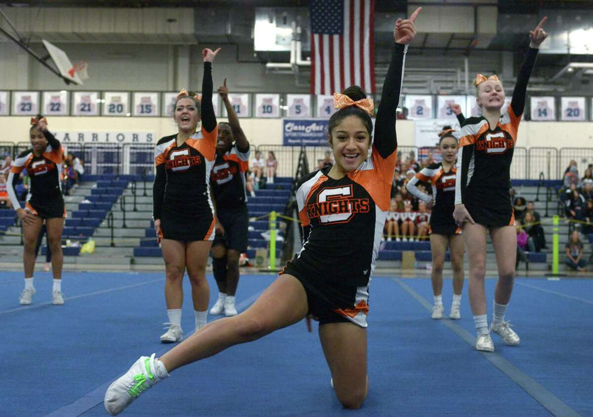 Gabriela Gonzalez leads the Stamford cheerleading squad during the FCIAC championships in Wilton on Saturday.
