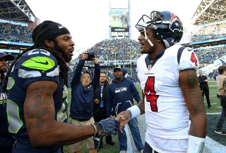 Seattle Seahawks cornerback Richard Sherman (25) and Houston Texans quarterback Deshaun Watson (4) shake hands after the game at CenturyLink Field Sunday, Oct. 29, 2017, in Seattle. The Seahawks won 41-38. ( Godofredo A. Vasquez / Houston Chronicle ) Photo: Godofredo A. Vasquez/Houston Chronicle