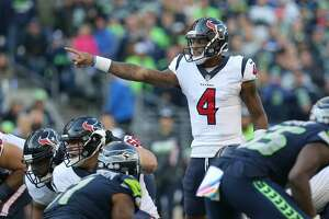 Houston Texans quarterback Deshaun Watson (4) makes a call at the line of scrimmage before snapping the ball against the Seattle Seahawks during the game at CenturyLink Field Sunday, Oct. 29, 2017, in Seattle. The Seahawks won 41-38. ( Godofredo A. Vasquez / Houston Chronicle )