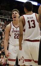 Stanford forward Reid Travis (22) celebrates his dunk with teammate Oscar Da Silva (13) during the second half of an NCAA college basketball game against Oregon, Saturday, Feb. 3, 2018, in Stanford, Calif. (AP Photo/Marcio Jose Sanchez)