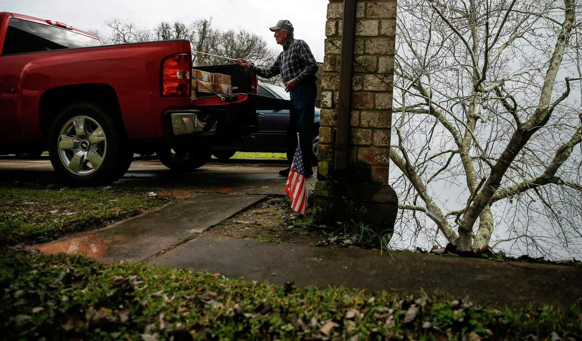 Homeowner James Unruh moves material into his truck Thursday, Jan. 11, 2018 as he works to repair his home that flooded during Hurricane Harvey in Friendswood. The city of Friendswood has reverted from 2007 flood maps to 1999 maps to allow homeowners that were flooded during the hurricane to rebuild without mandating expensive home elevation requirements. ( Michael Ciaglo / Houston Chronicle)