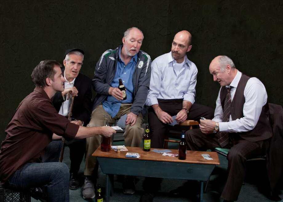 Old friends gather for a night of cards where the stakes are devilishly high in Capital Rep's production of The Seafarer. The cast, from left, includes Declan Mooney, Peter Rogan, Michael Judd, Timothy Deenihan and Edward James Hyland. (Joe Schuyler)