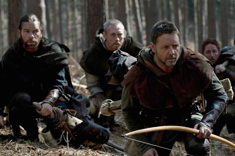 "Allan A'Dayle (ALAN DOYLE), Little John (KEVIN DURAND), Robin Longstride (RUSSELL CROWE) and Will Scarlet (SCOTT GRIMES) hunt their quarry in ""Robin Hood"", the epic action-adventure about the legendary figure whose exploits have endured in popular mythology and ignited the imagination of those who share his spirit of adventure and righteousness. ( David Appleby) Photo: Photo Credit: David Appleby"