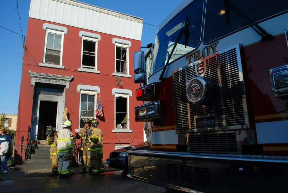 Troy firefighters work at the scene of a Wednesday morning fire at 367 1st St. in Troy. (Paul Buckowski / Times Union) Photo: PAUL BUCKOWSKI