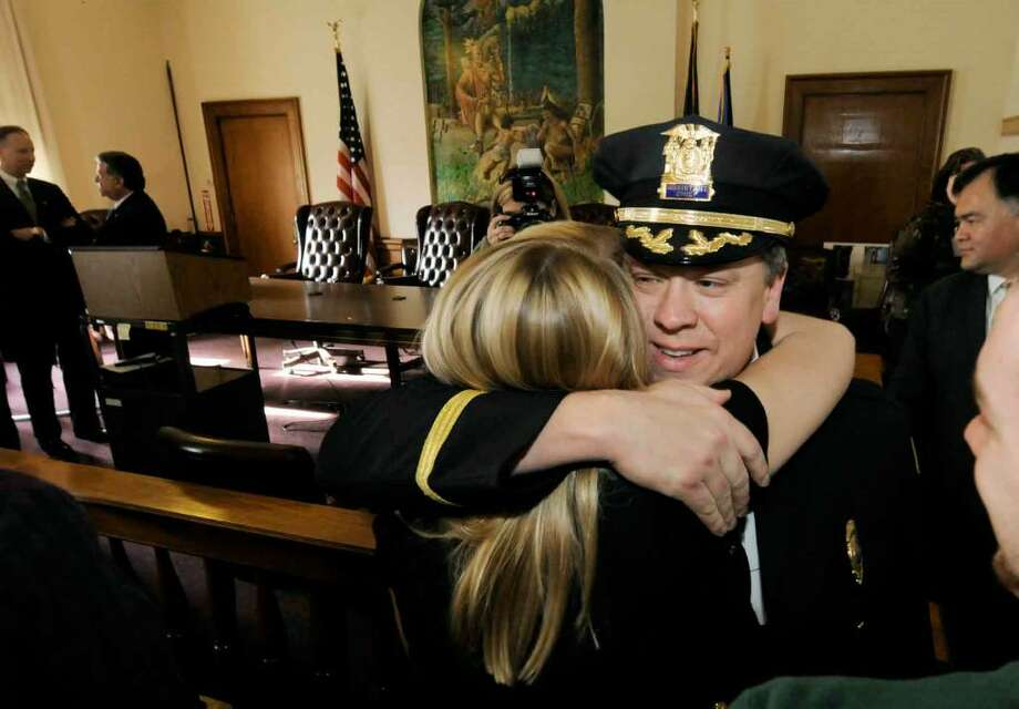 Newly promoted police chief Christoper Cole receives a hug from his daughter Andrea Cole after a news conference naming him the new chief at City Hall in Saratoga Springs on Dec. 4. (Michael P. Farrell/Albany Times Union) Photo: MICHAEL P. FARRELL