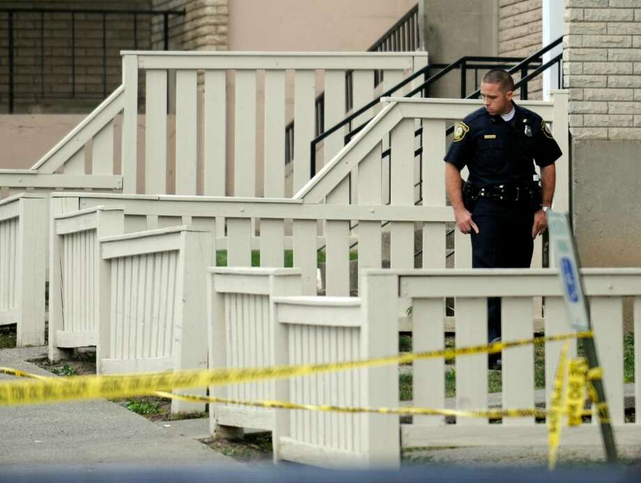 Albany police officers scrutinize the area near 270 N. Pearl St. for clues about the killing of a man Tuesday night.   (Skip Dickstein / Times Union) Photo: SKIP DICKSTEIN
