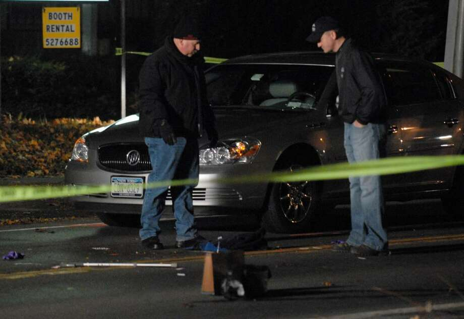 Bethlehem police investigate an apparent car-pedestrian accident on Kenwood Avenue near the intersection of Delaware Avenue in Delmar Friday evening Nov., 6, 2009. (Will Waldron / Times Union)