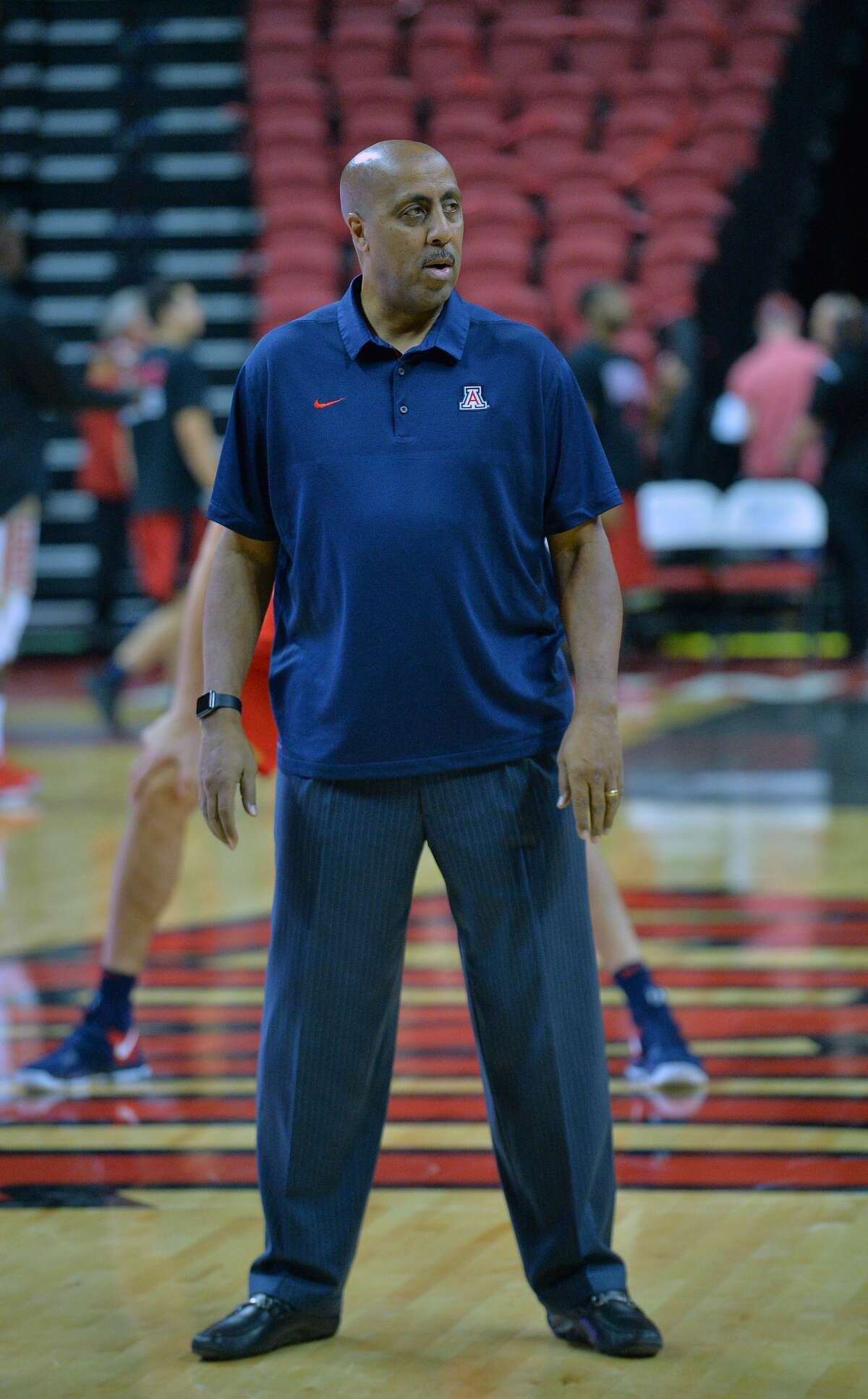 LAS VEGAS, NV - DECEMBER 02: Associate head coach Lorenzo Romar of the Arizona Wildcats stands on the court during warmups before his team's game against the UNLV Rebels at the Thomas & Mack Center on December 2, 2017 in Las Vegas, Nevada. (Photo by Sam Wasson/Getty Images)