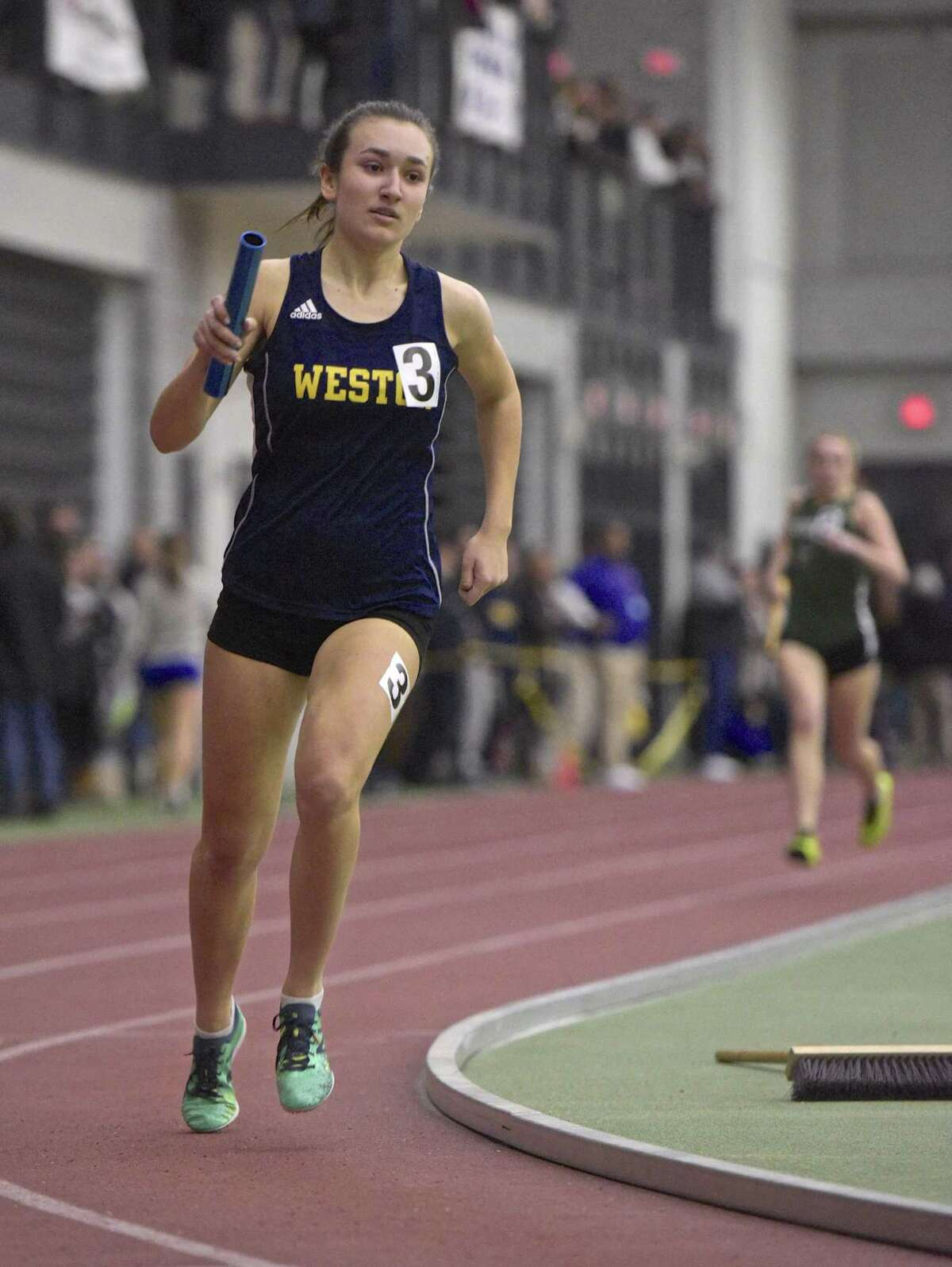 Weston's Michelle Gutowski competes in the 4x800 meter relay in the SWC girls indoor track championship at Floyd Little Athletic Center, New Haven, Conn, on Saturday night, February 3, 2018.