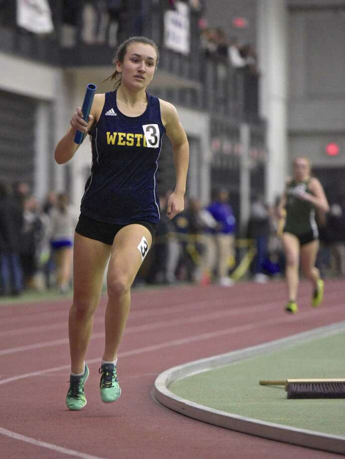Weston's Michelle Gutowski competes in the 4x800 meter relay in the SWC girls indoor track championship at Floyd Little Athletic Center, New Haven, Conn, on Saturday night, February 3, 2018. Photo: H John Voorhees III / Hearst Connecticut Media / The News-Times