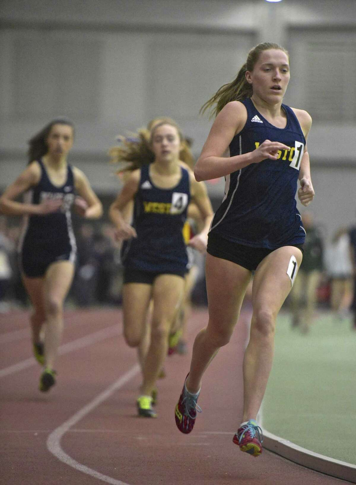 Weston's Kathleen Murphy competes in the 1000 meter run in the SWC girls indoor track championship at Floyd Little Athletic Center, New Haven, Conn, on Saturday night, February 3, 2018.