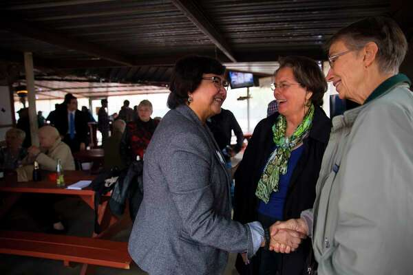 Democratic gubernatorial candidate Lupe Valdez, left, chats with Rebecca Shield and Edna Kelly during a meet-and-greet.