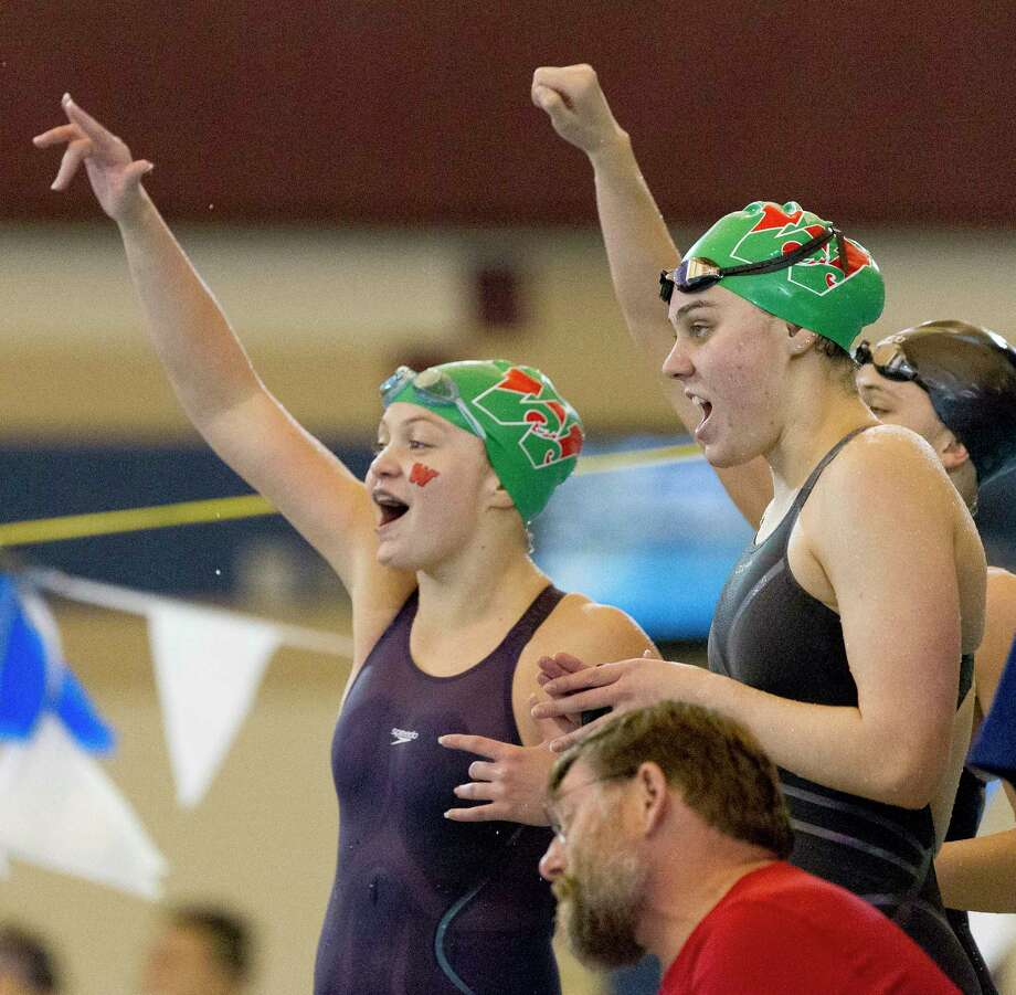 The Woodlands celebrates after winning the girls 400-yard freestyle relay during the Region IV-6A Swimming & Diving Championships at the Conroe ISD Natatorium, Saturday, Feb. 3, 2018, in Shenandoah. Photo: Jason Fochtman, Staff Photographer / © 2018 Houston Chronicle