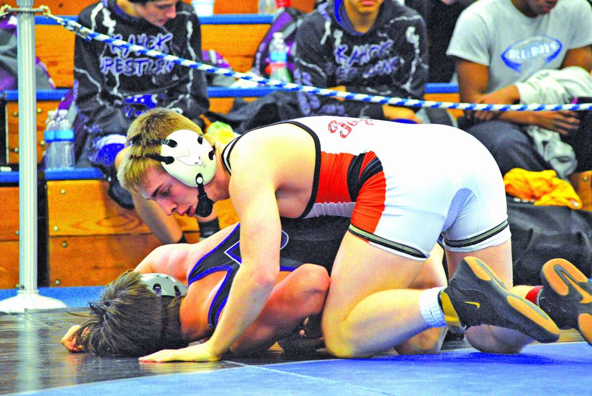 Edwardsville sophomore Will Zupanci, top, wrestles Drew Evans of Collinsville during the 138-pound championship match.