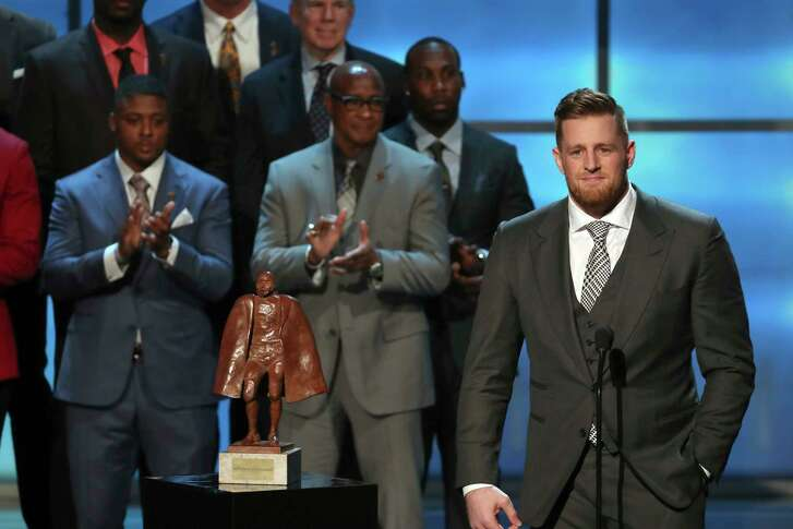 The Texans' J.J. Watt, right, was honored as the recipient of the Walter Payton Man of the Year Award, becoming only the fourth defensive lineman to win the award in its 48-year history and joining Warren Moon as one of two Houston athletes to win it.