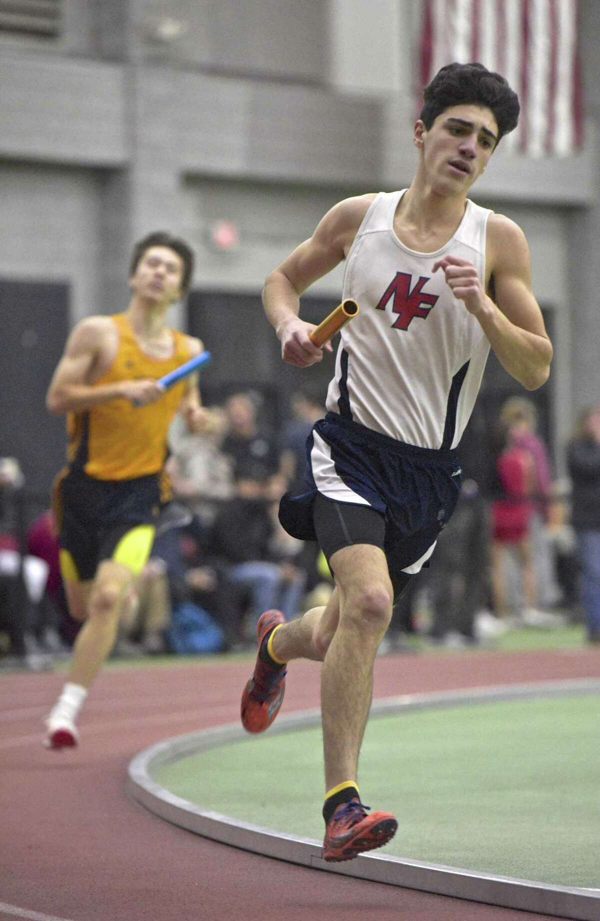 New Fairfield's Anthony Golino competes in the 4 x 800 meter relay in the SWC boys indoor track championship at Floyd Little Athletic Center, New Haven, Conn, on Saturday night, February 3, 2018.