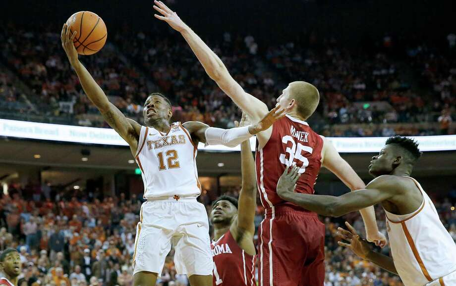 AUSTIN, TX - FEBRUARY 3: Kerwin Roach II #12 of the Texas Longhorns shoots the ball against Brady Manek #35 of the Oklahoma Sooners as Mohamed Bamba #4 of the Texas Longhorns defends him at the Frank Erwin Center on February  3, 2018 in Austin, Texas. Photo: Chris Covatta, Getty Images / 2018 Getty Images