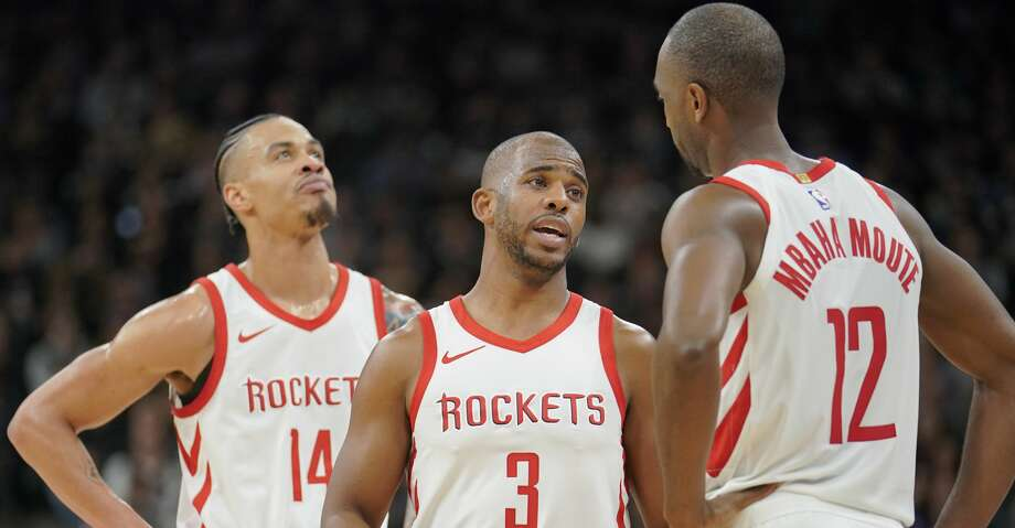 Houston Rockets' Chris Paul (3) talks to teammates Luc Mbah a Moute (12) and Gerald Green during the first half of an NBA basketball game against the San Antonio Spurs, Thursday, Feb. 1, 2018, in San Antonio. Houston won 102-91. (AP Photo/Darren Abate) Photo: Darren Abate/Associated Press