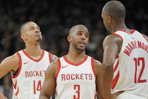 Houston Rockets' Chris Paul (3) talks to teammates Luc Mbah a Moute (12) and Gerald Green during the first half of an NBA basketball game against the San Antonio Spurs, Thursday, Feb. 1, 2018, in San Antonio. Houston won 102-91. (AP Photo/Darren Abate)