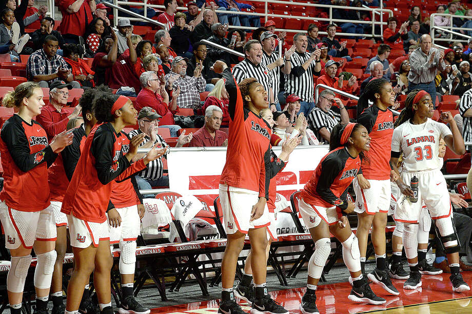 Lamar's bench explodes as they take the lead against Stephen F. Austin during the women's match-up at the Montagne Center Saturday. Photo taken Saturday, February 3, 2018 Kim Brent/The Enterprise Photo: Kim Brent, Beaumont Enterprise / BEN