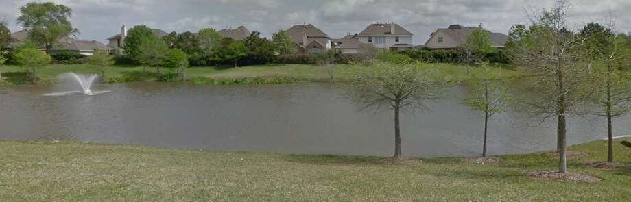 An unidentified woman's body was found Saturday afternoon in this Brazoria County subdivision pond.