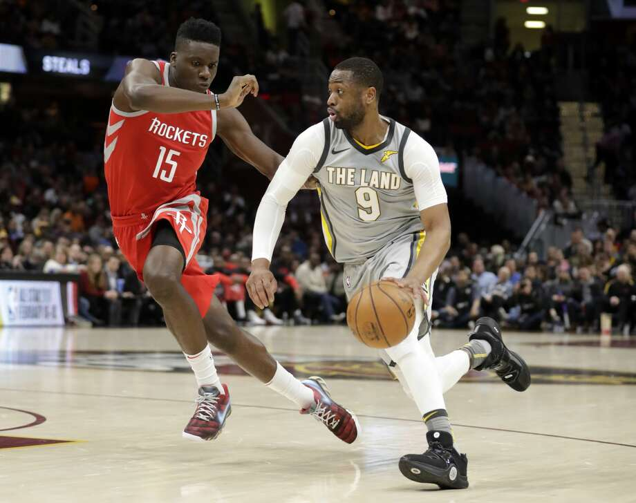Cleveland Cavaliers' Dwyane Wade (9) drive against Houston Rockets' Clint Capela (15), from Switzerland, in the first half of an NBA basketball game, Saturday, Feb. 3, 2018, in Cleveland. (AP Photo/Tony Dejak) Photo: Tony Dejak/Associated Press