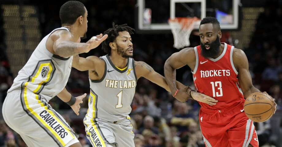 Houston Rockets' James Harden, right, drives past Cleveland Cavaliers' Channing Frye, left, and Derrick Rose in the second half of an NBA basketball game, Saturday, Feb. 3, 2018, in Cleveland. The Rockets won 120-88. (AP Photo/Tony Dejak) Photo: Tony Dejak/Associated Press