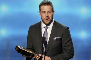 In this photo provided by the NFL, Case Keenum of the Minnesota Vikings accepts the award for Bridgestone Performance Play of the Year at the 7th Annual NFL Honors at the Cyrus Northrop Memorial Auditorium on Saturday, Feb. 3, 2018, in Minneapolis. (Photo by Michael Zorn/Invision for NFL/AP Images)