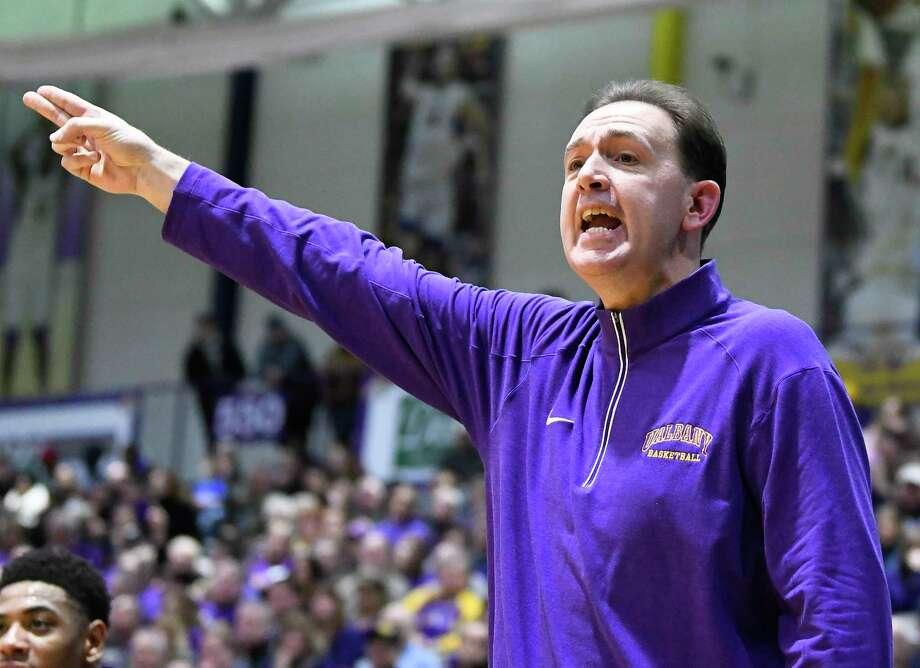 UAlbany's head coach Will Brown instructs his players against New Hampshire during the first half of an NCAA men's college basketball game Saturday, Feb. 3, 2018, in Albany, N.Y. (Hans Pennink / Special to the Times Union) Photo: Hans Pennink / Hans Pennink