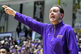 UAlbany's head coach Will Brown instructs his players against New Hampshire during the first half of an NCAA men's college basketball game Saturday, Feb. 3, 2018, in Albany, N.Y. (Hans Pennink / Special to the Times Union)