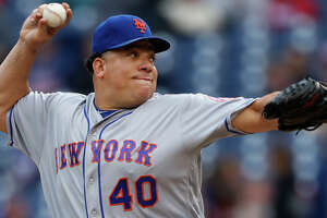 FILE - In this Oct. 1, 2016, file photo, New York Mets starting pitcher Bartolo Colon throws in the first inning of a baseball game against the Philadelphia Phillies, in Philadelphia. A person familiar with the situation says the Atlanta Braves have added another 40-year-old to their starting rotation, agreeing to terms with Bartolo Colon. The person spoke on condition of anonymity to The Associated Press because no announcement is expected from the Braves until next week on the reported $12.5 million, one-year deal with the 43-year-old Colon. (AP Photo/Laurence Kesterson, File)