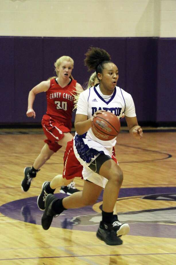 Dayton senior Tayelin Grays was chased all night by Caney Creek defenders but never caught. Grays closed out her final game with another stellar performance. Photo: David Taylor