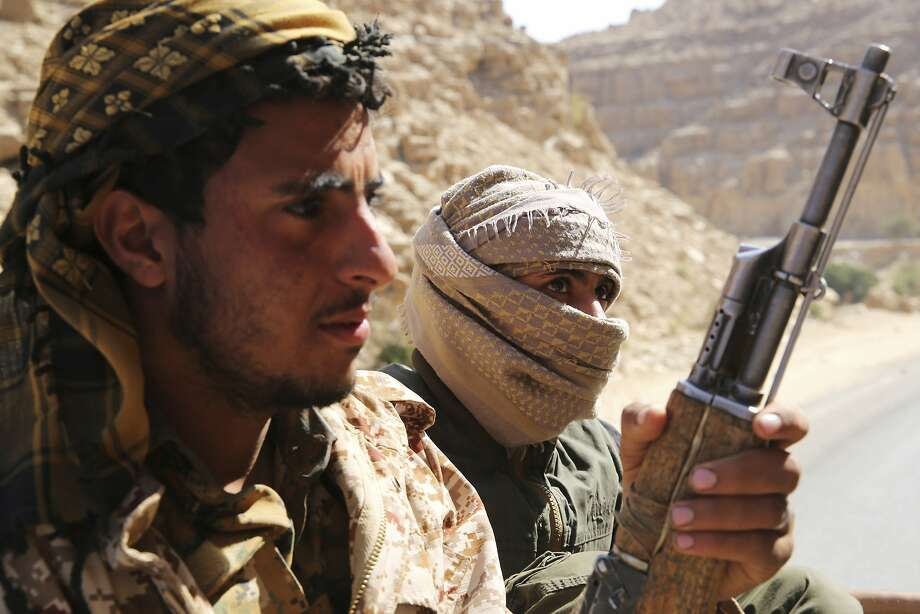 In this Friday, Feb. 2, 2018, photo, Yemeni militiamen allied to the country's internationally recognized government prepare to climb a mountain in the outskirts of Sanaa, Yemen. Yemen's conflict, which began as a civil war in 2014 and escalated into a regional proxy fight, drags on today. Winning the hardscrabble terrain takes time and costs dearly, only exacerbating the country's humanitarian crises and making a war that's seen over 10,000 people killed last that much longer. (AP Photo/Jon Gambrell) Photo: Jon Gambrell, Associated Press