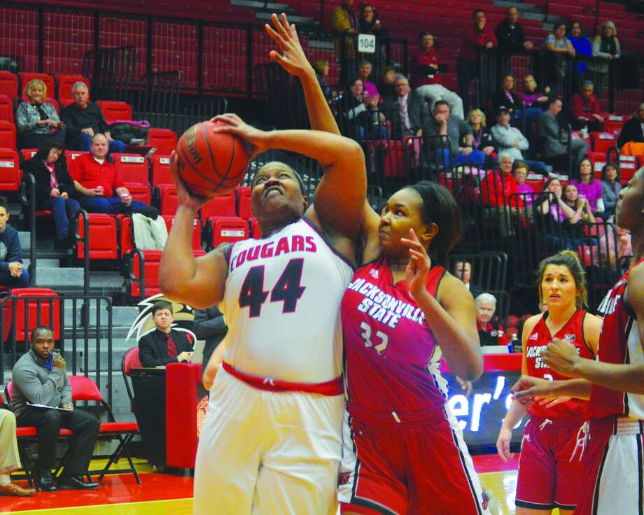 SIUE center Gwen Adams, left, is fouled as she goes up for a shot during Saturday's game against Jacksonville State.