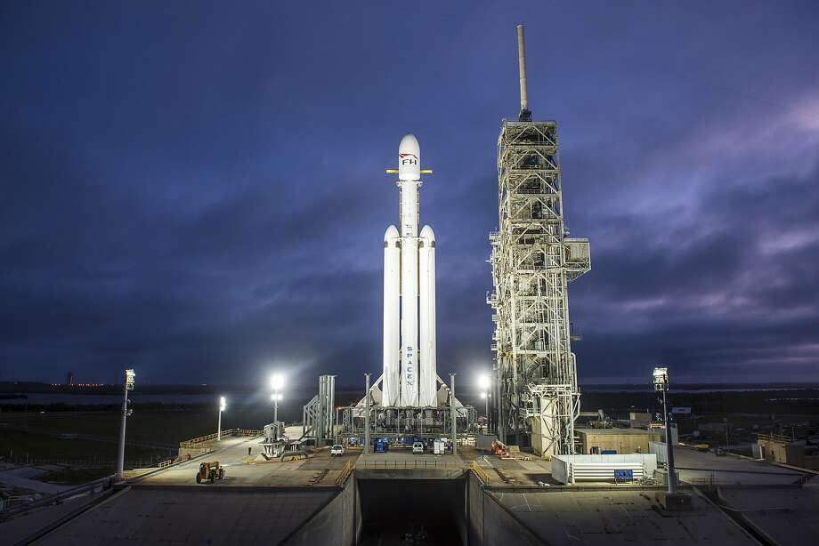 The Falcon Heavy rocket will make its first flight as soon as Tuesday from Cape Canaveral. Its three boosters strapped side by side and 27 engines make it the most powerful working rocket. Photo: Associated Press