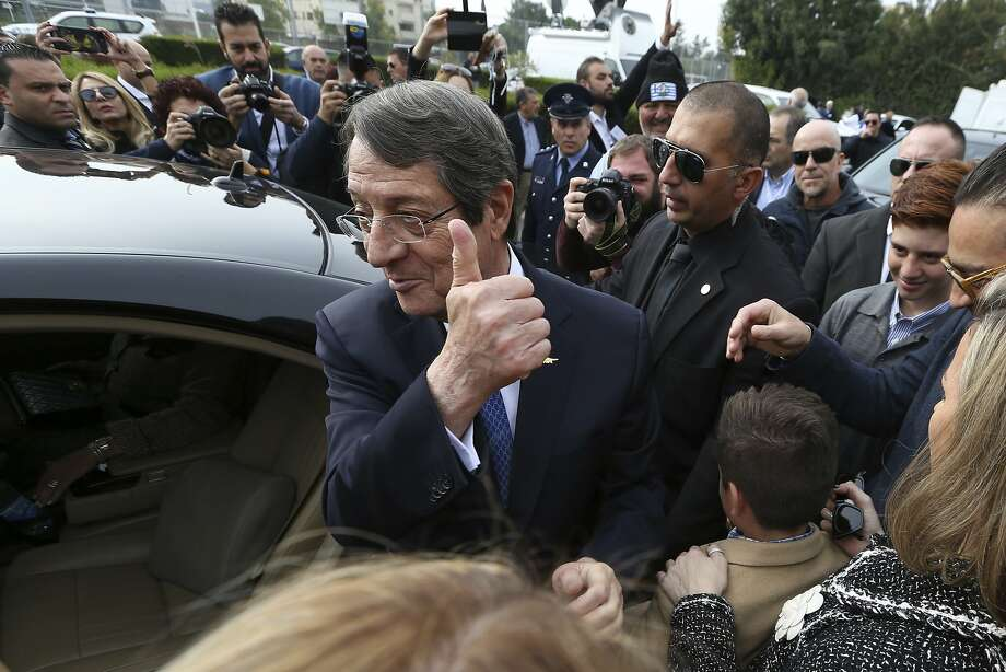 Cyprus President Nicos Anastasiades greets supporters after casting his ballot in the southern city of Limassol. Anastasiades defeated challenger Stavros Malas by a wide margin. Photo: Petros Karadjias, Associated Press