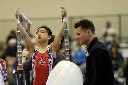 Asher Hong, of Cypress Academy of Gymnastics, perpares for his turn on the parallel bars during the Houston National Invitational gymnastics meet at NRG Center, Saturday, Feb. 3, 2018, in Houston. Even while USA Gymnastics at its upper levels is being buffeted by problems, some of its own making, some not, the sport continues on the local level and kids who will never make it to the Olympics or to a college team still work hard and enjoy the sport. ( Karen Warren / Houston Chronicle )