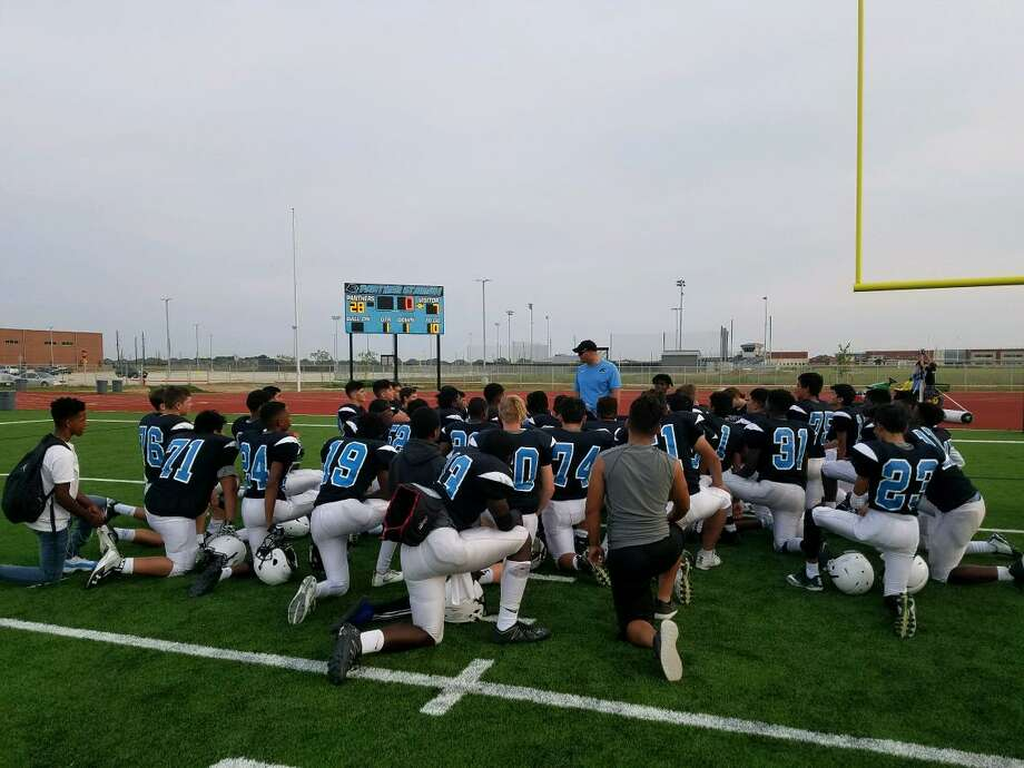 The Paetow sophomore football team meets after its first victory Sept. 13 against Tompkins. The Panthers will play their first varsity season this fall, assigned to UIL District 10-5A Division II. Photo: Paetow High School