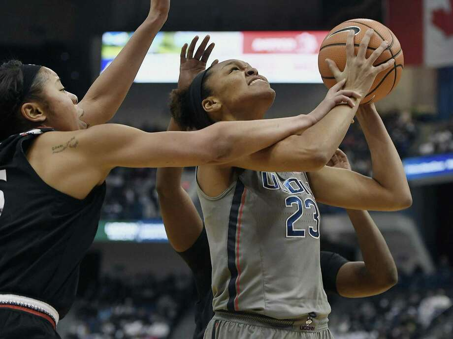 Cincinnati's Chelsea Warren, left, fouls UConn's Azura Stevens Sunday in Hartford. Photo: Jessica Hill / Associated Press / AP2018