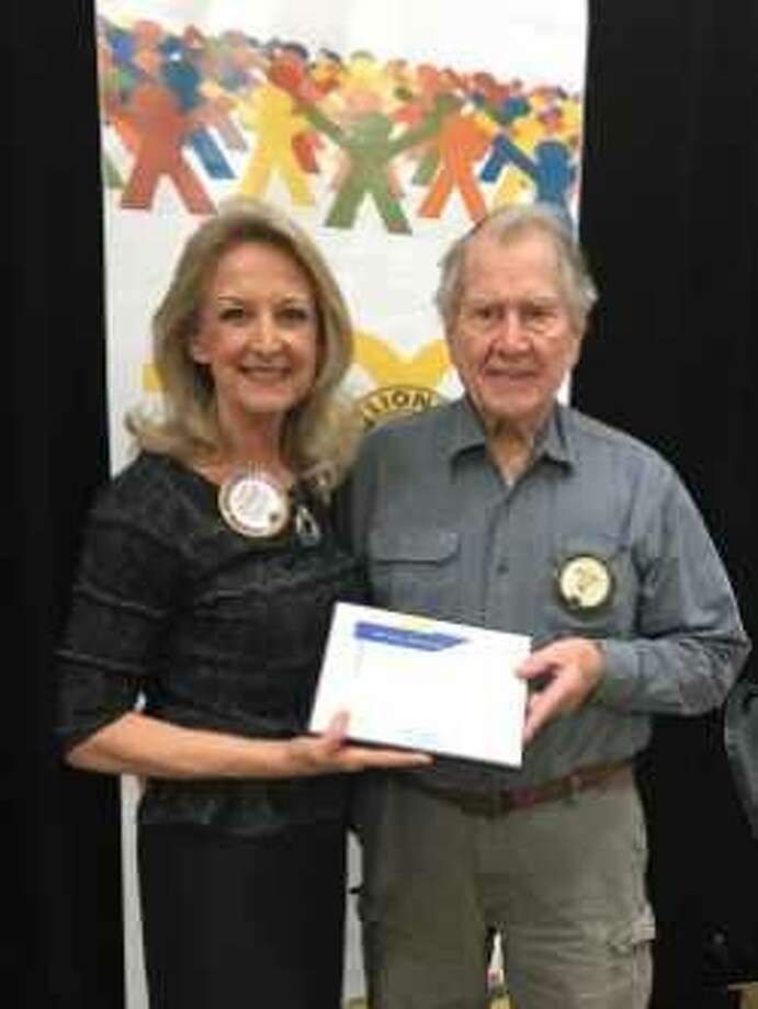 Conroe Noon Lions celebrated the anniversaries of club members with Monarch awards for years of service last week; and Lion Lowie Rice, right, DVM received top honors with 40 years, presented by President Helen Thornton, left. Photo: Submitted Photo