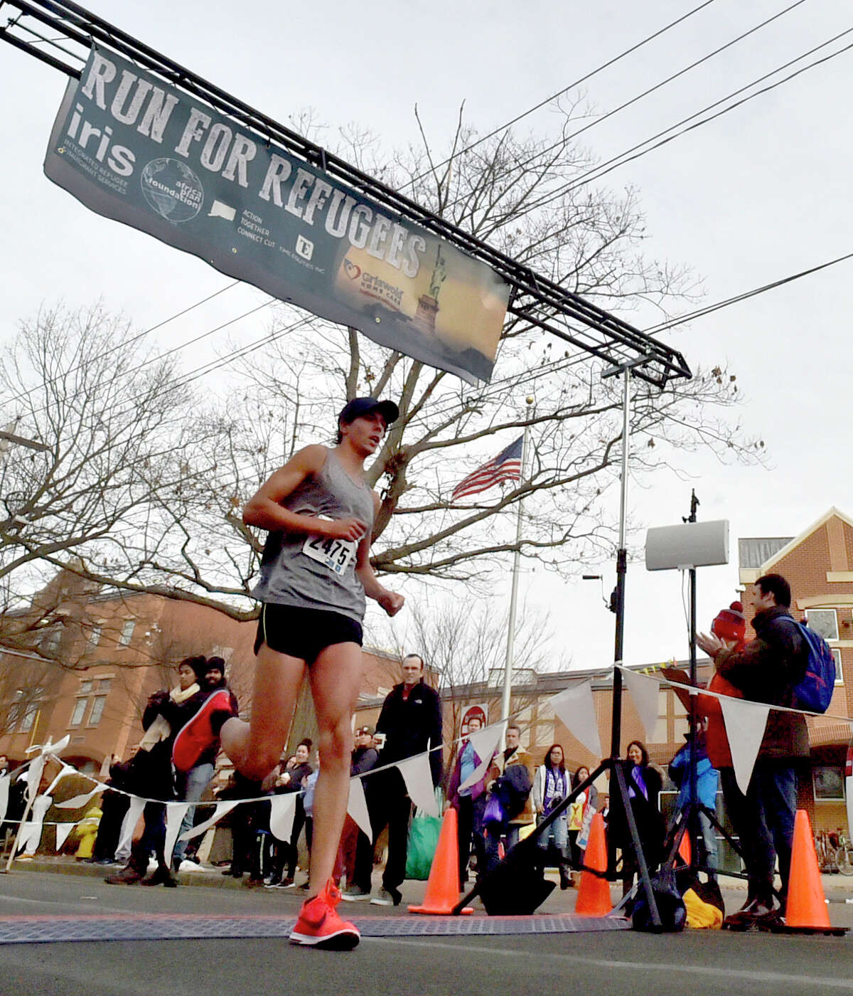 New Haven, Connecticut - Friday, February 4, 2018: First place winner Sam Montclair of North Haven, crosses the finish line of the The IRIS (Integrated Refugee & Immigrant Services)