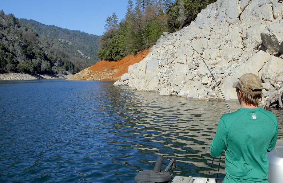 Jeremy Keyston hooks up along rocky bottom at Shasta Lake, where temperatures are forecast to hit the 80s on Thursday -- in the middle of winter Photo: Tom Stienstra, Tom Stienstra / The Chronicle