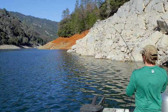 Jeremy Keyston hooks up along rocky bottom at Shasta Lake, where temperatures are forecast to hit the 80s on Thursday -- in the middle of winter