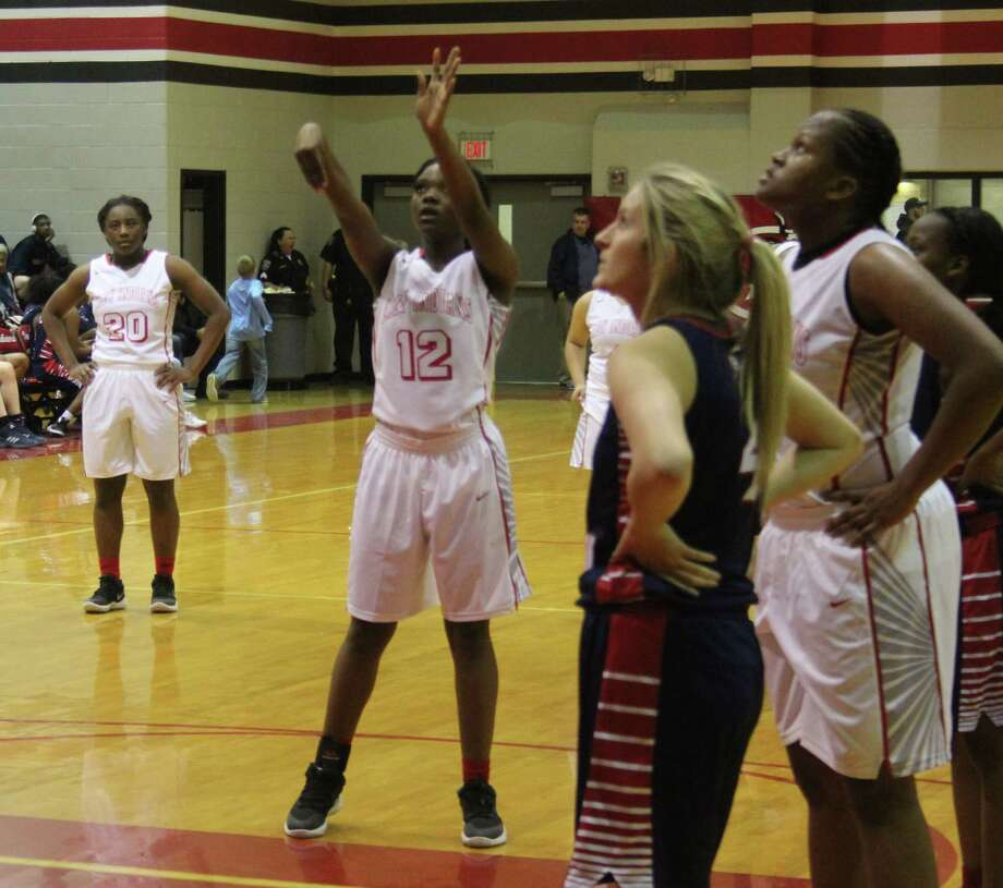 Lady Indian Ajaliah Ogiemwonyi (12) launches the ball for a free throw. Photo: Jacob McAdams