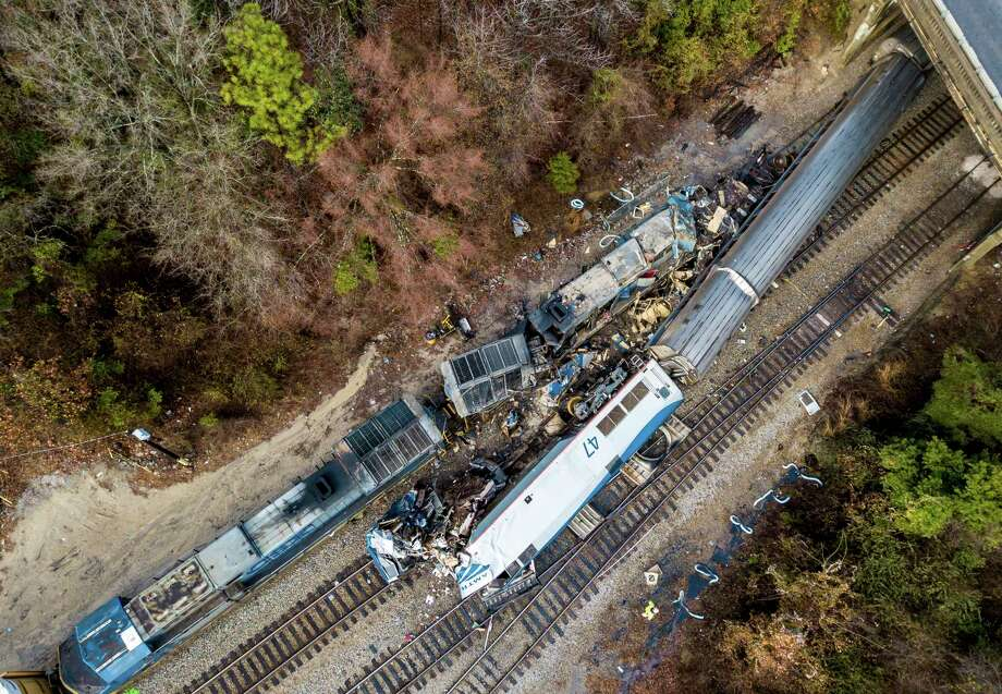 An early morning train crash Sunday between an Amtrak train, bottom right, and a CSX freight train killed at least two Amtrak workers and injured scores of sleeping passengers. Photo: Jeff Blake, FRE / AP