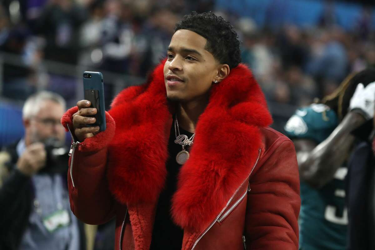 Christian Casey Combs uses his cell phone prior to Super Bowl LII between the New England Patriots and the Philadelphia Eagles at U.S. Bank Stadium on February 4, 2018 in Minneapolis, Minnesota.