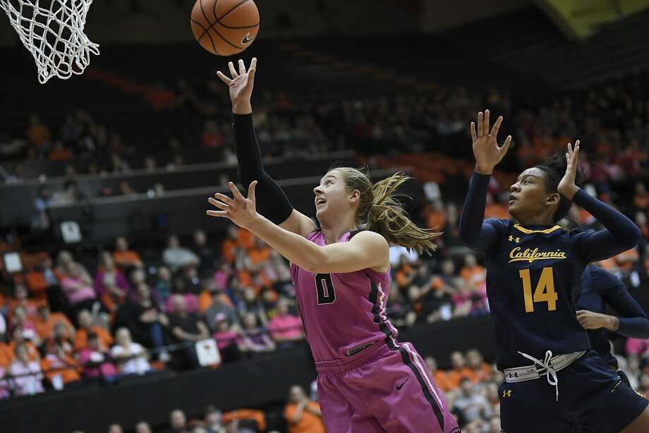 Oregon State guard Mikayla Pivec (0) races to the basket past California guard Kianna Smith (14) during an NCAA college basketball game Sunday, Feb. 4, 2018, in Corvallis, Ore. (Amanda Loman/Albany Democrat-Herald via AP) Photo: Amanda Loman, Associated Press