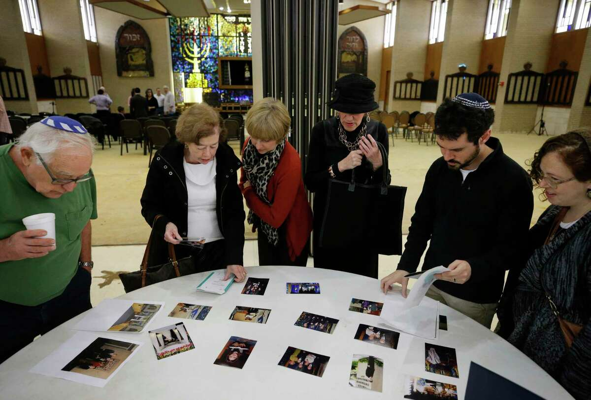 Congregants view a display of photos during a final service at United Orthodox Synagogues. The building was damaged by three recent floods: Memorial Day 2015, Tax Day 2016 and Hurricane Harvey.